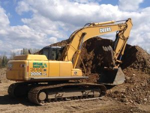 equipment next to dirt pile